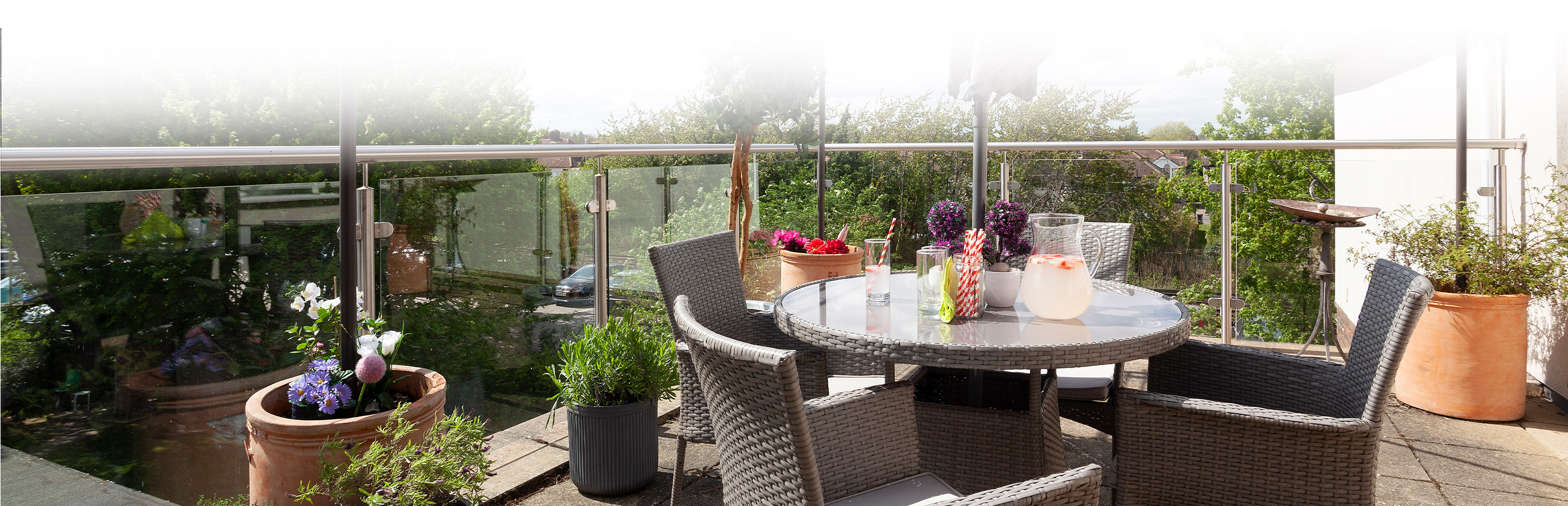 Outdoor dining table with drinks and nice view at Priory Court Care Home Epsom