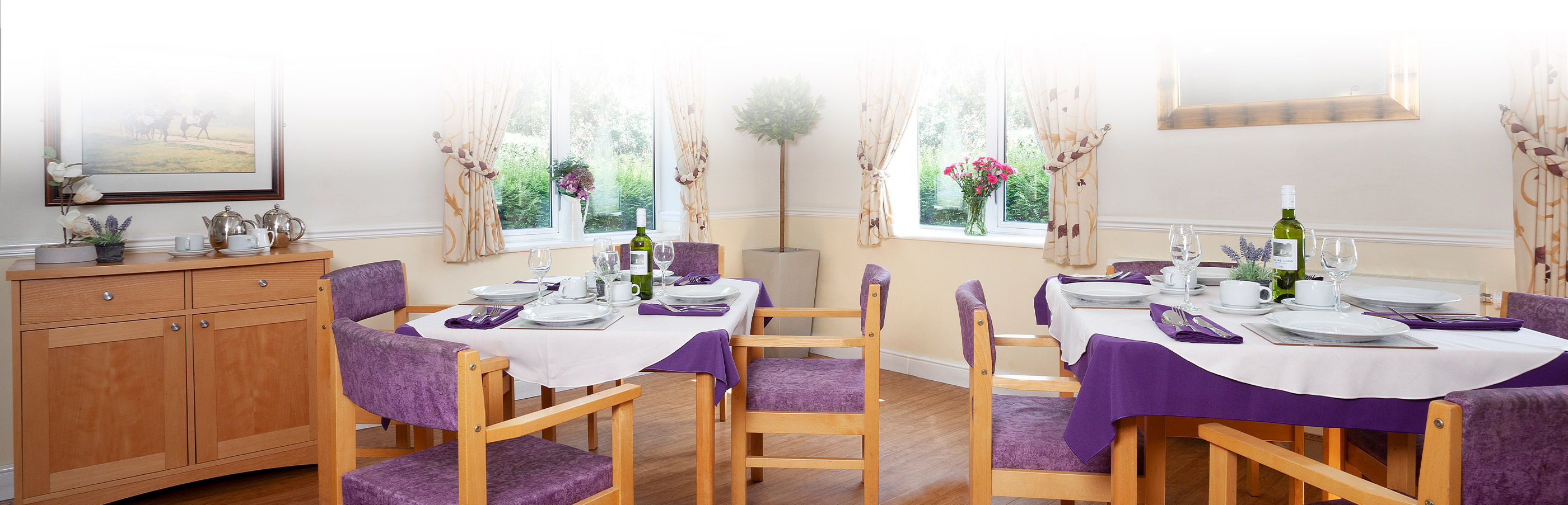 Living space with purple chairs at priory court care home epsom